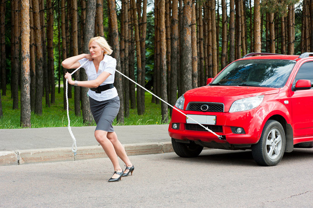 towing_woman_car_tire